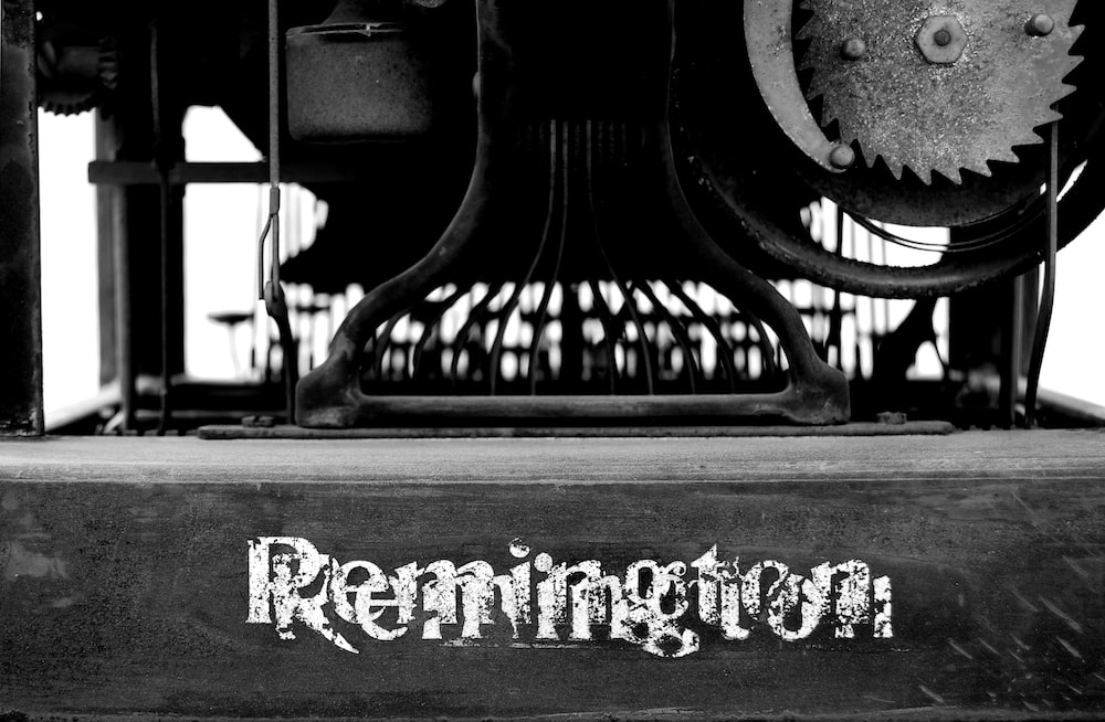 greyscale photography of Remington table machine
