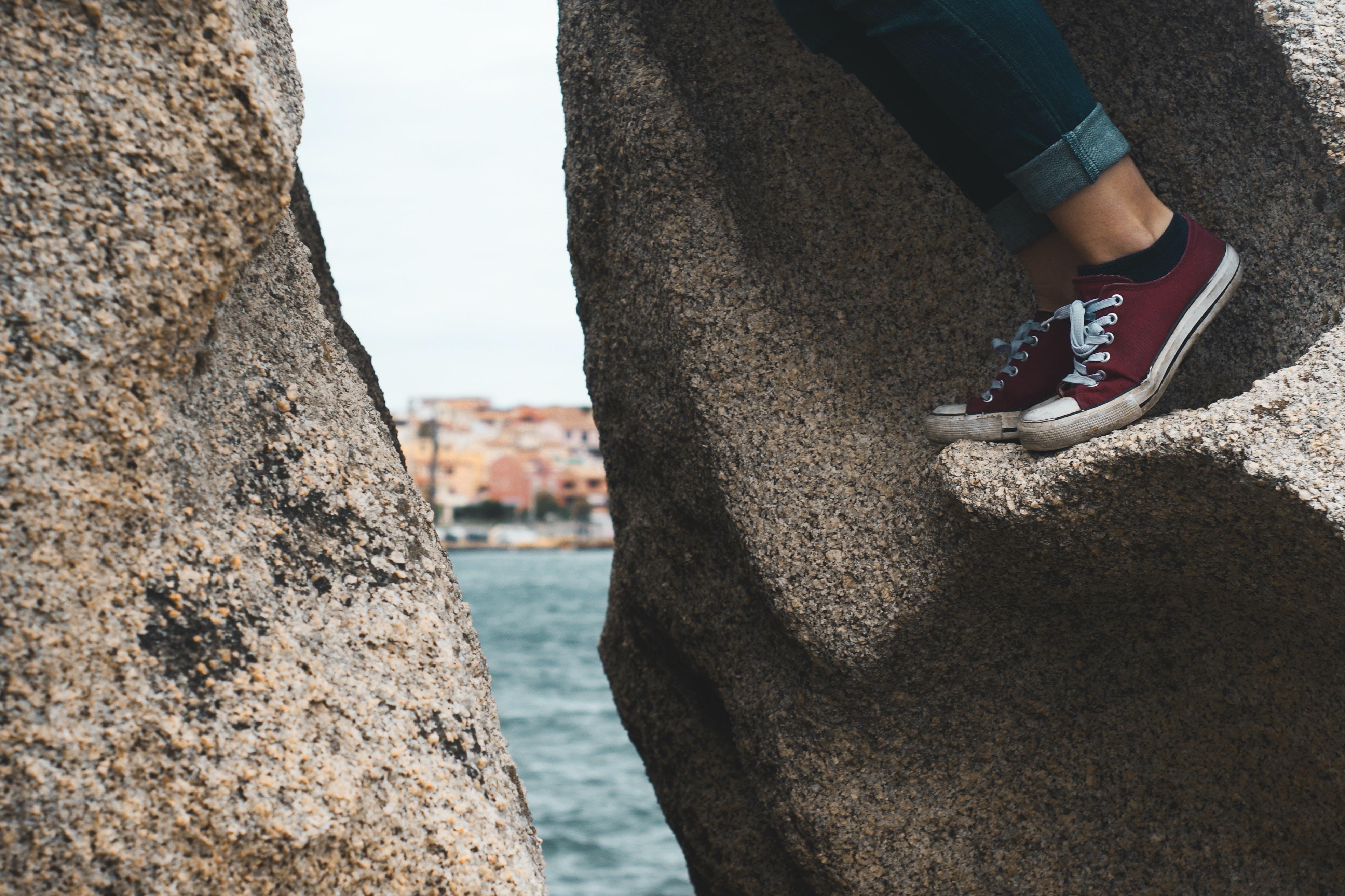 person climbing rocks
