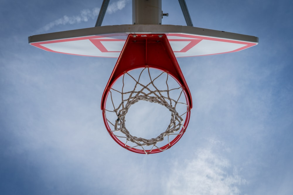 high-angle photography of red and white basketball system