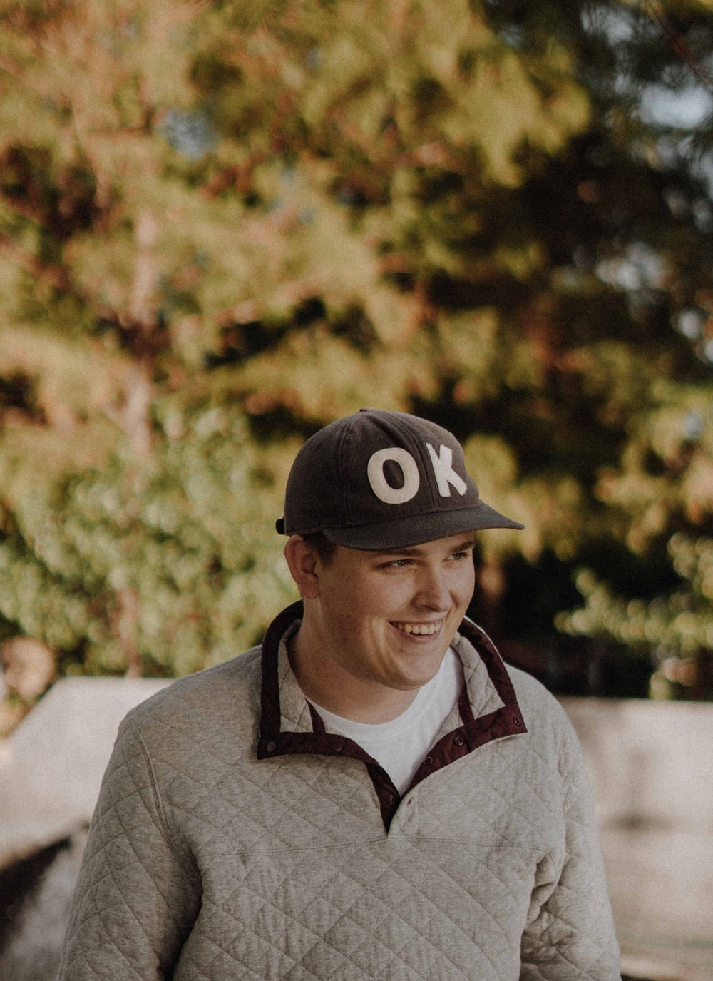 man in Ok cap and gilet