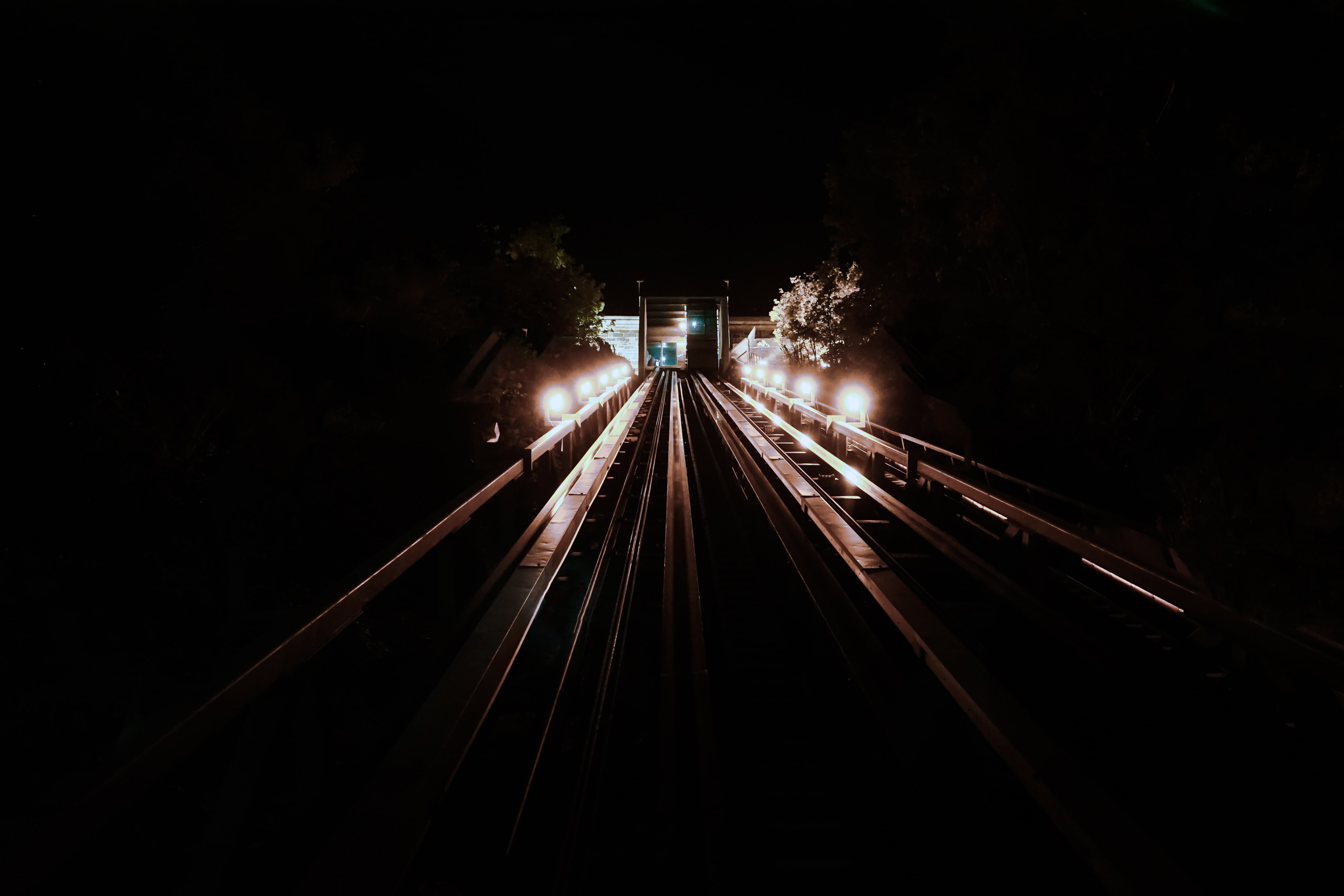 train track with light at night time