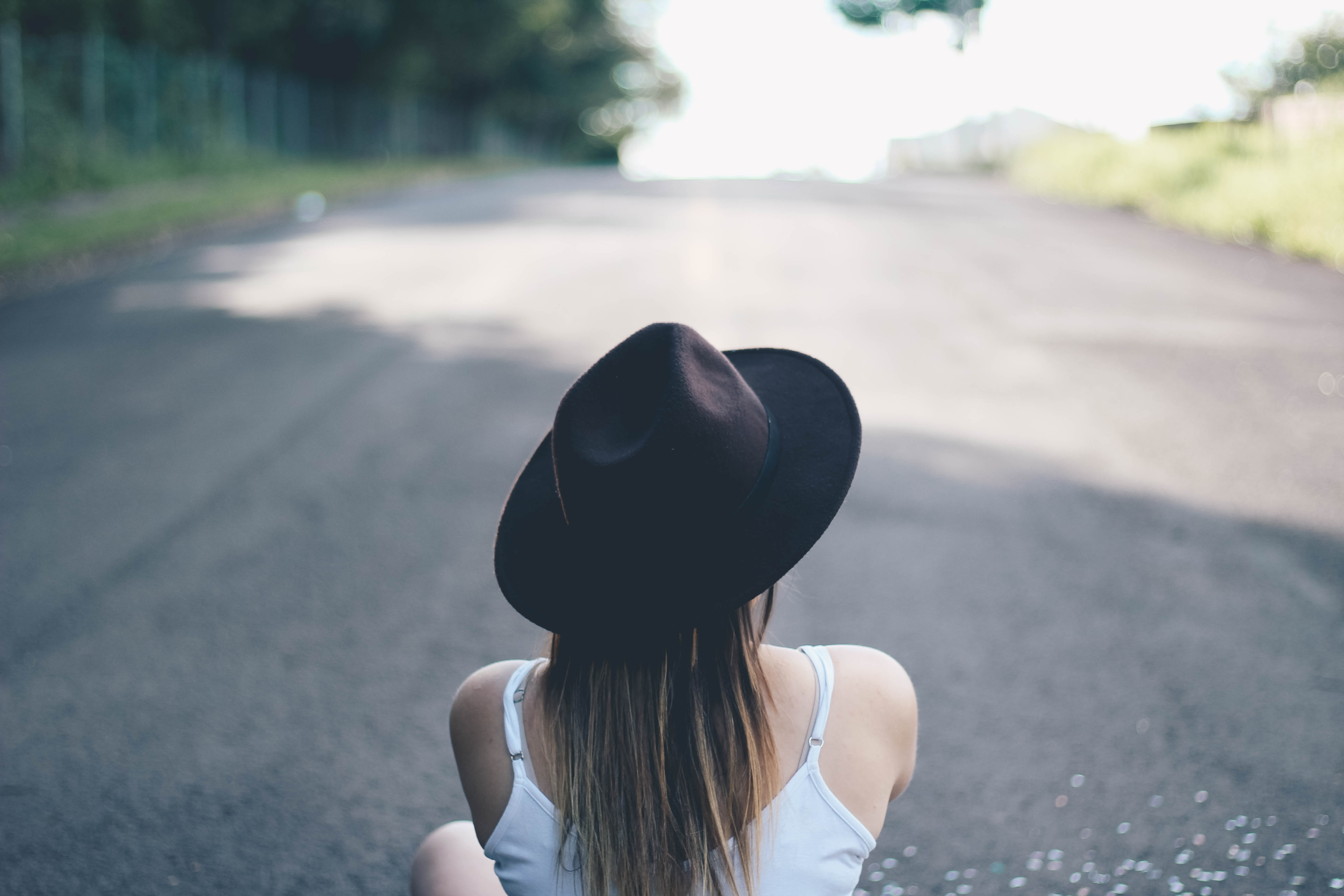 woman sitting in the middle of the road