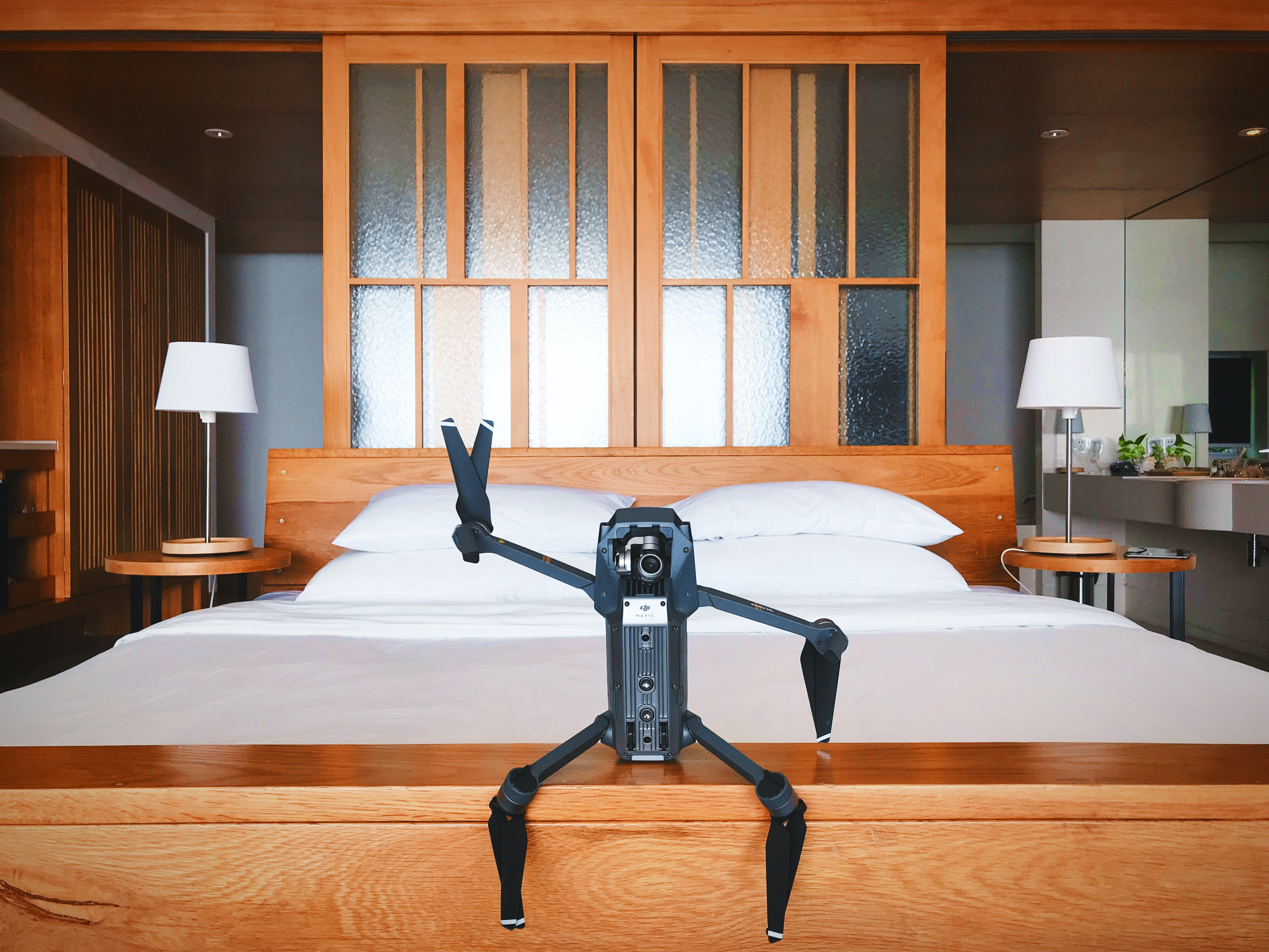 black quadcopter drone on brown wooden table