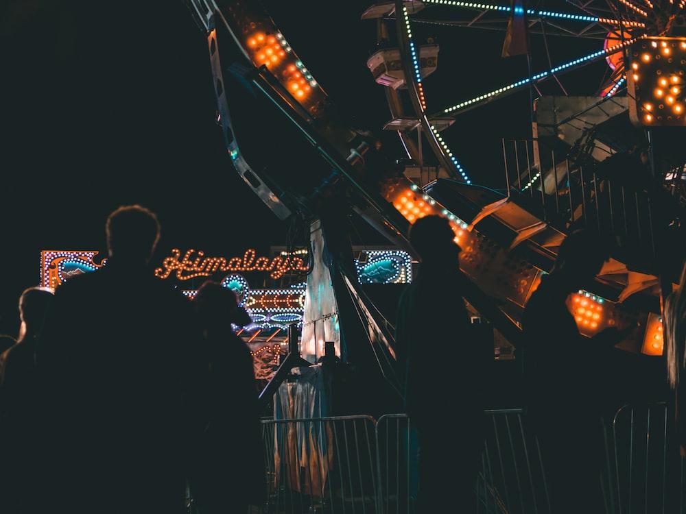 silhouette of person near Ferris wheel