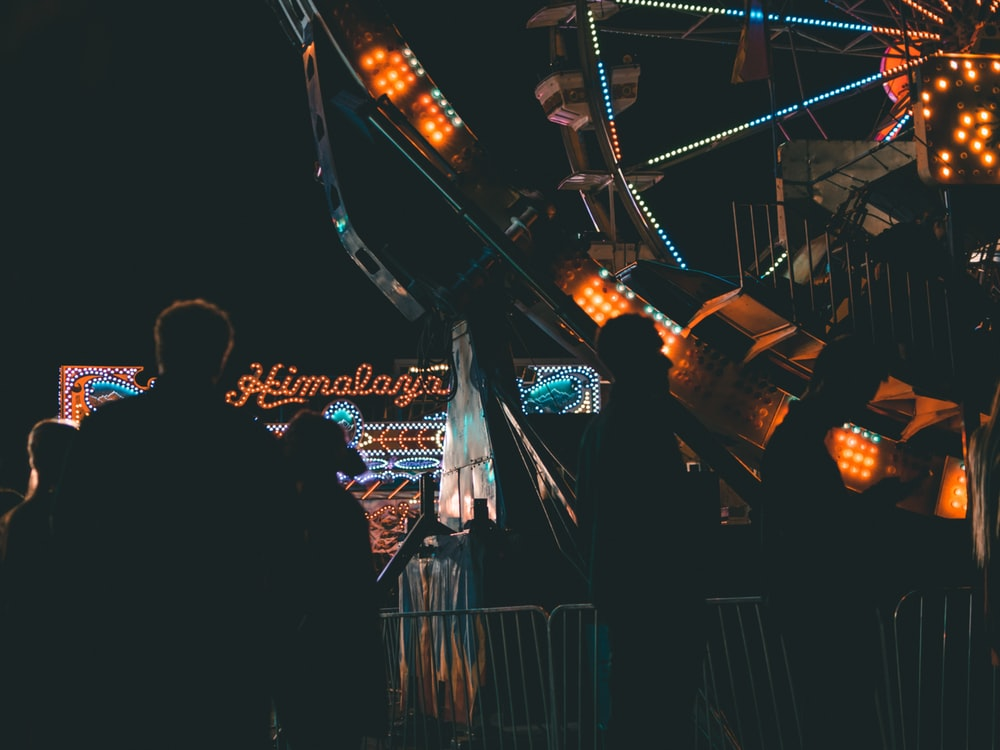 silhouette of person near Ferris wheel