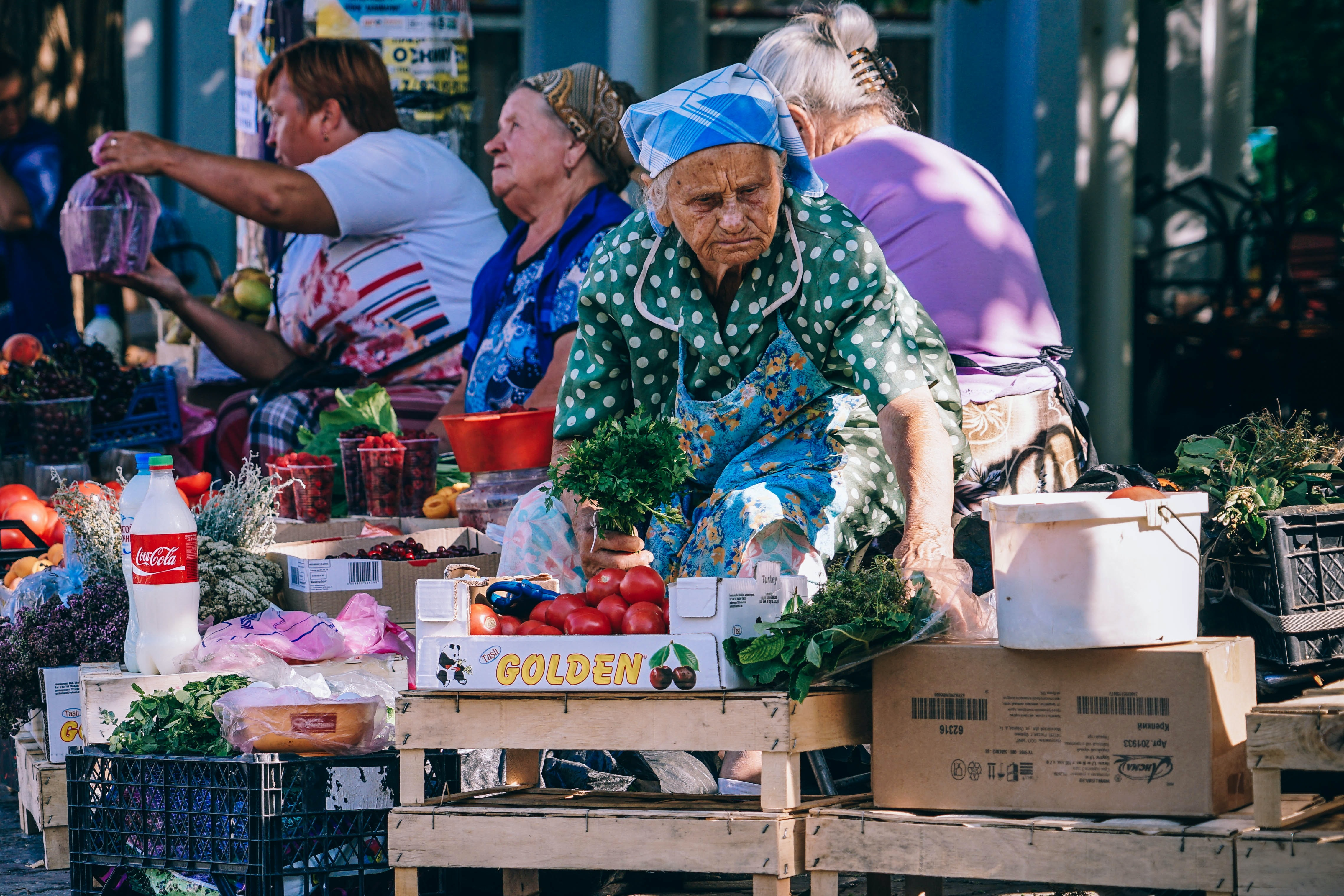 woman vending tomatoes on stall