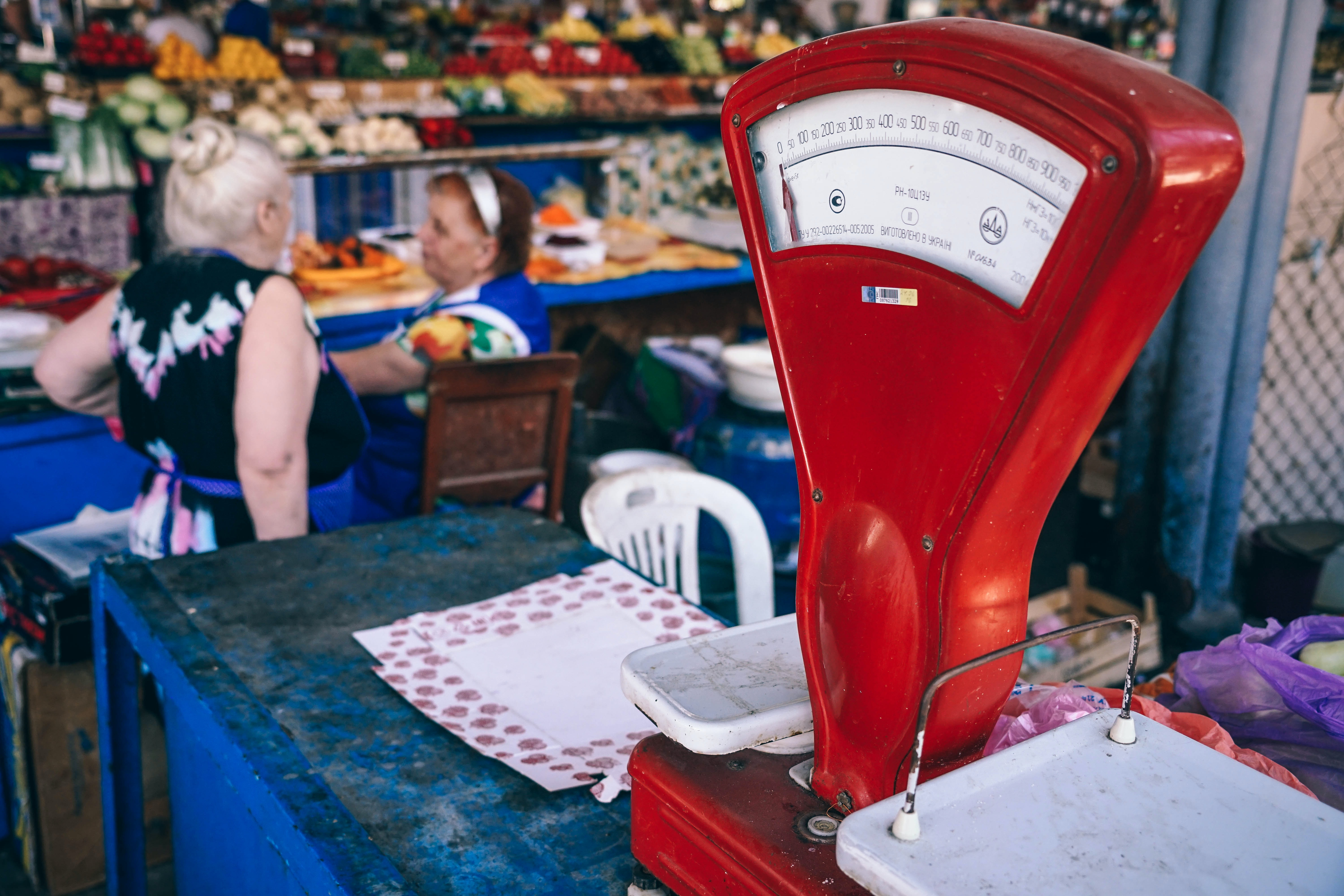 photo of red analog postage scale