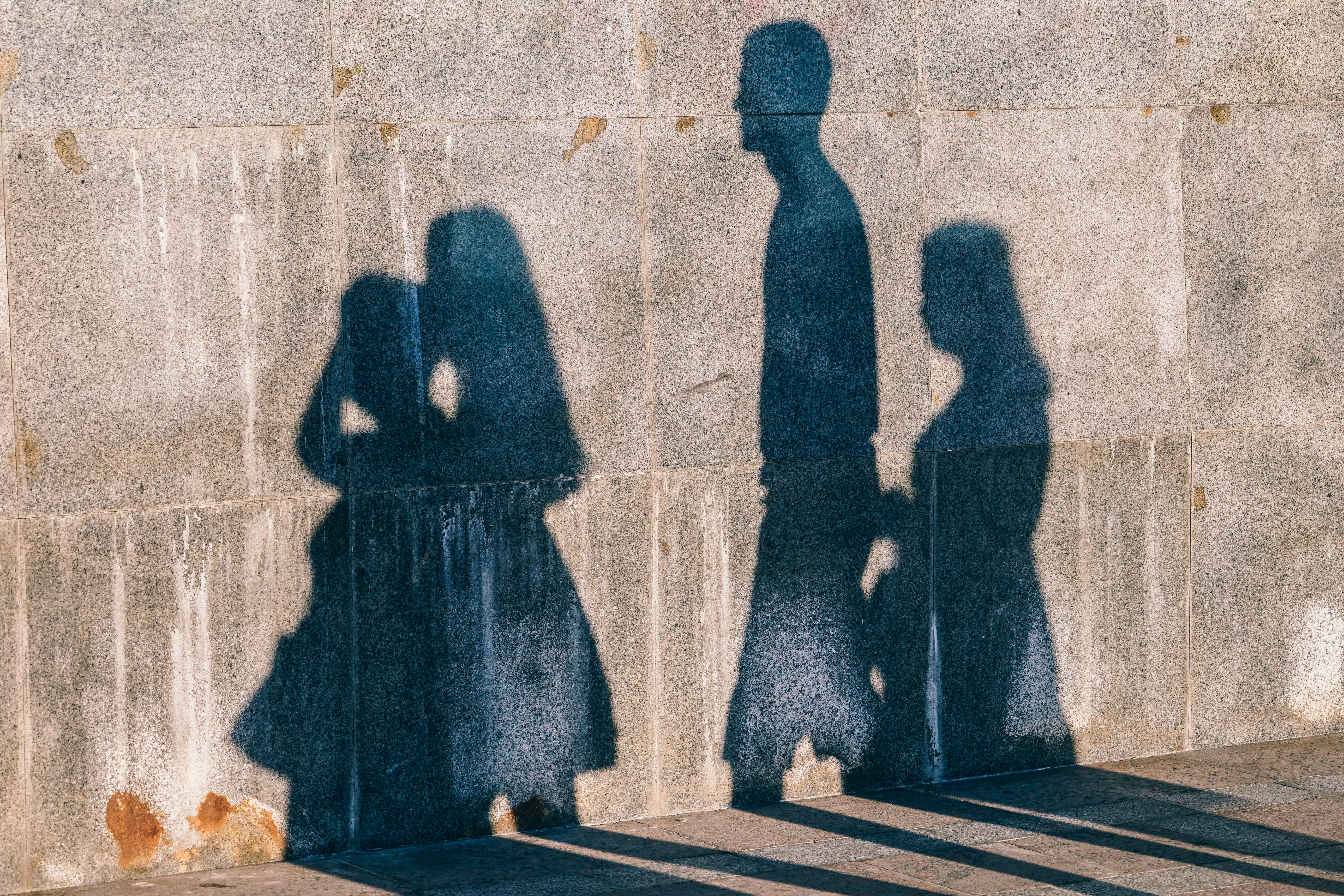 shadow of four people on wall