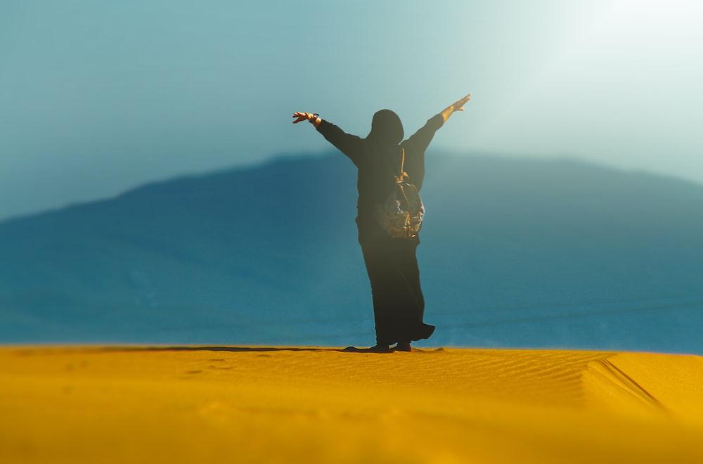 person standing on desert