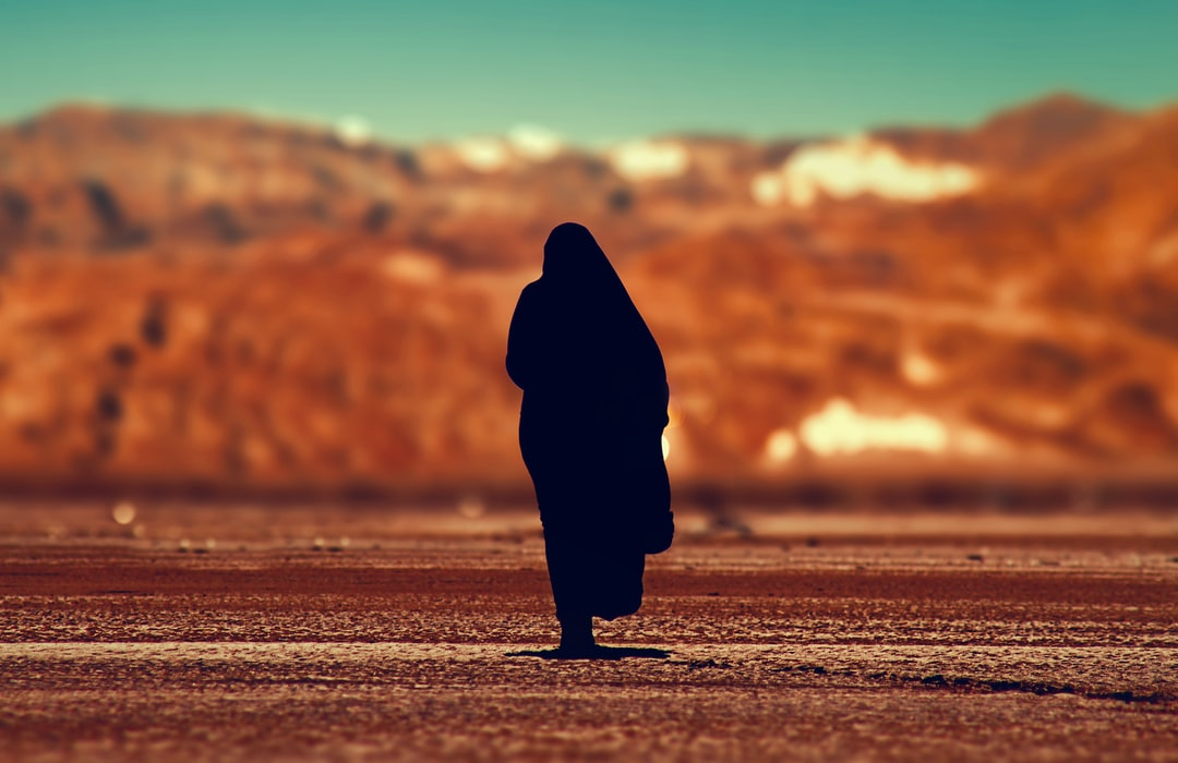 silhouette of person walking on ground at daytime in Tahadart Morocco