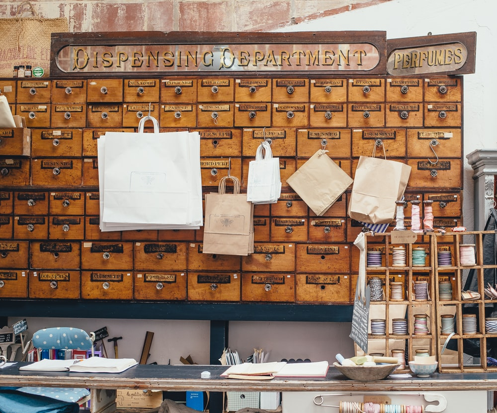 photo of brown wooden file cabinet