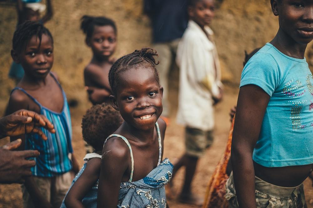 children smiling closeup photography