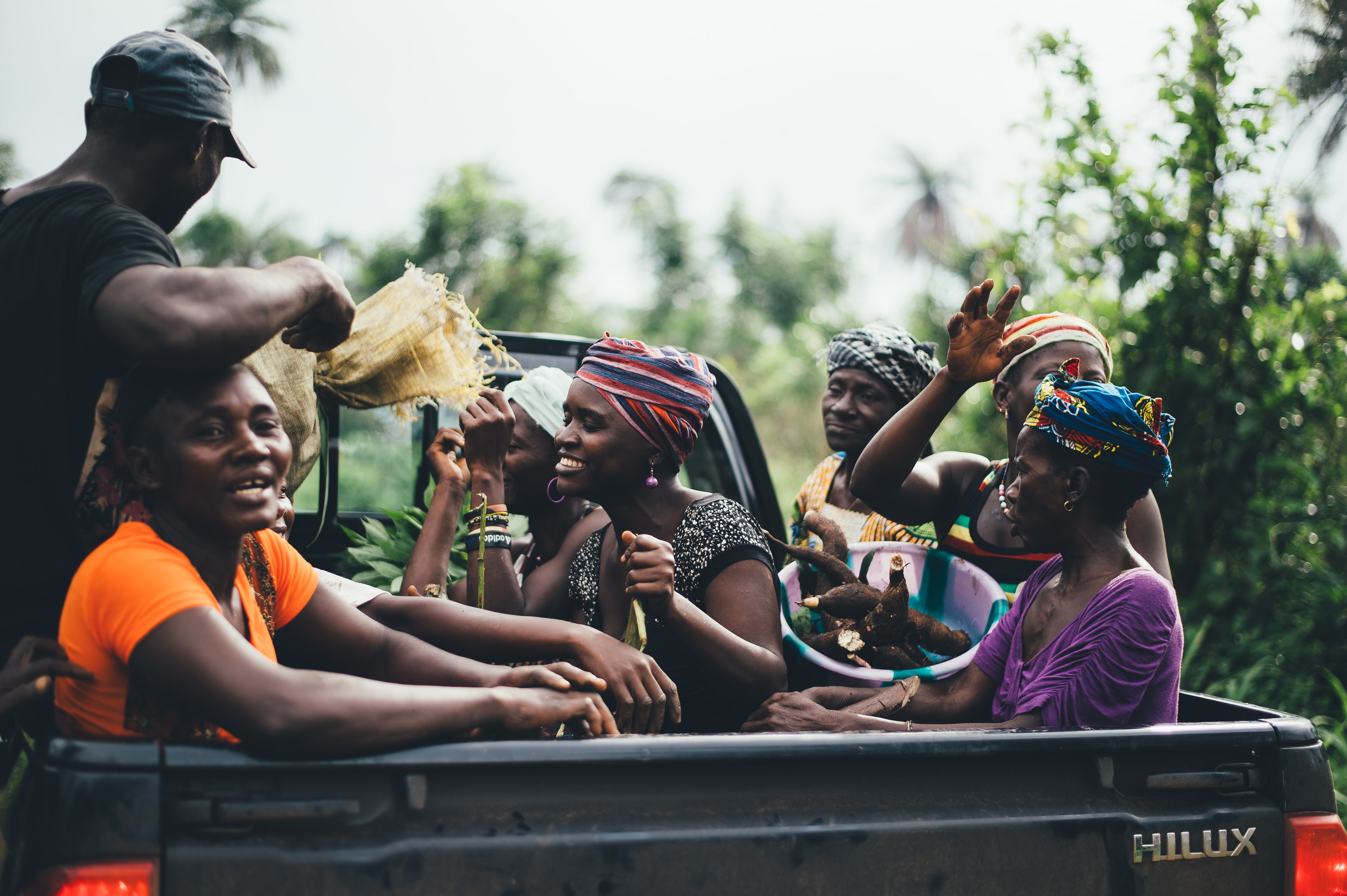 group of people on black Toyota Hilux truck bed