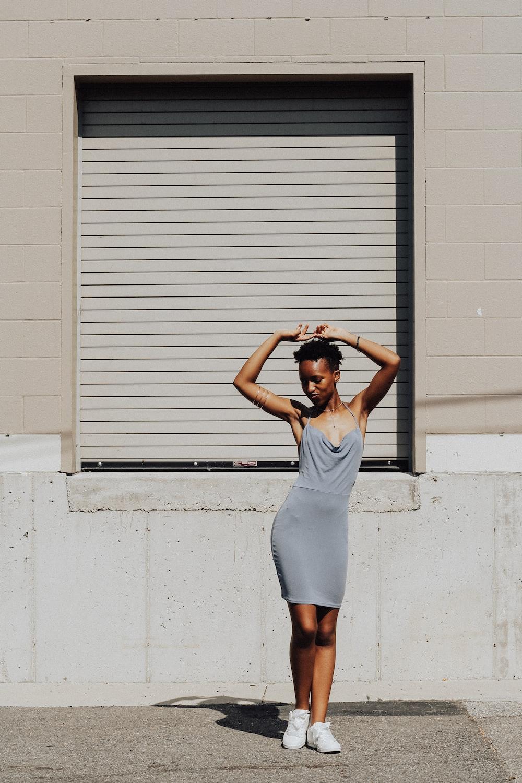 woman standing near white window