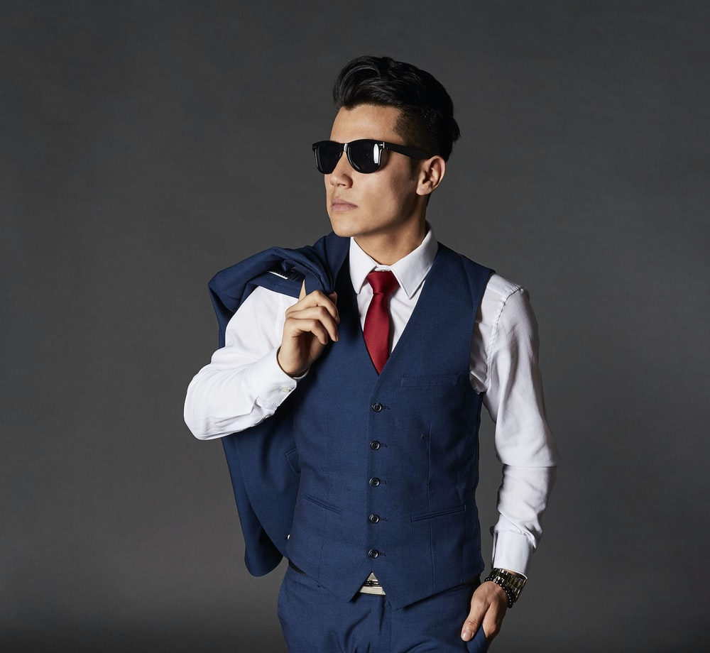 standing man with suit and sunglasses