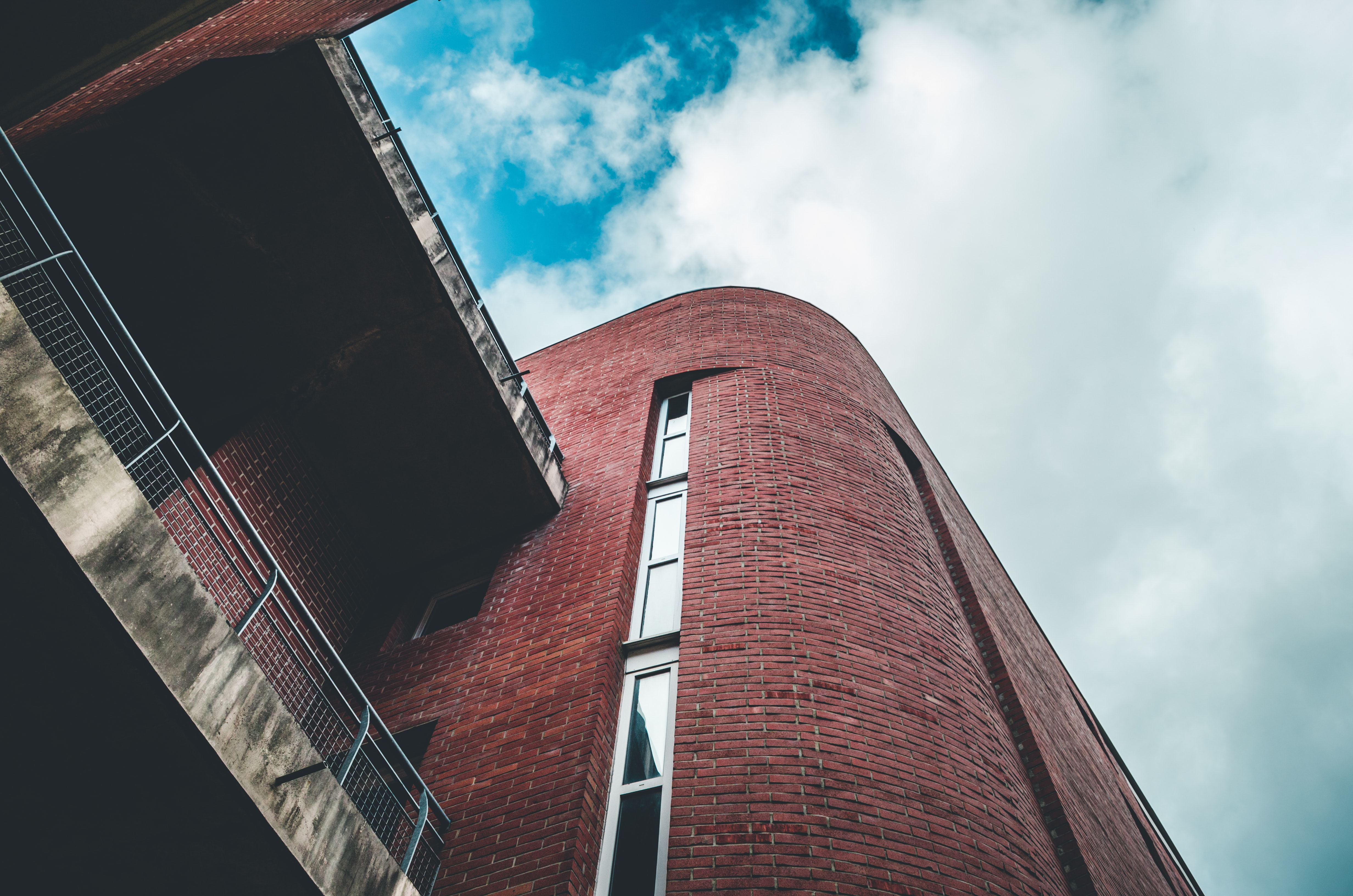 low angle photography of clay brick building