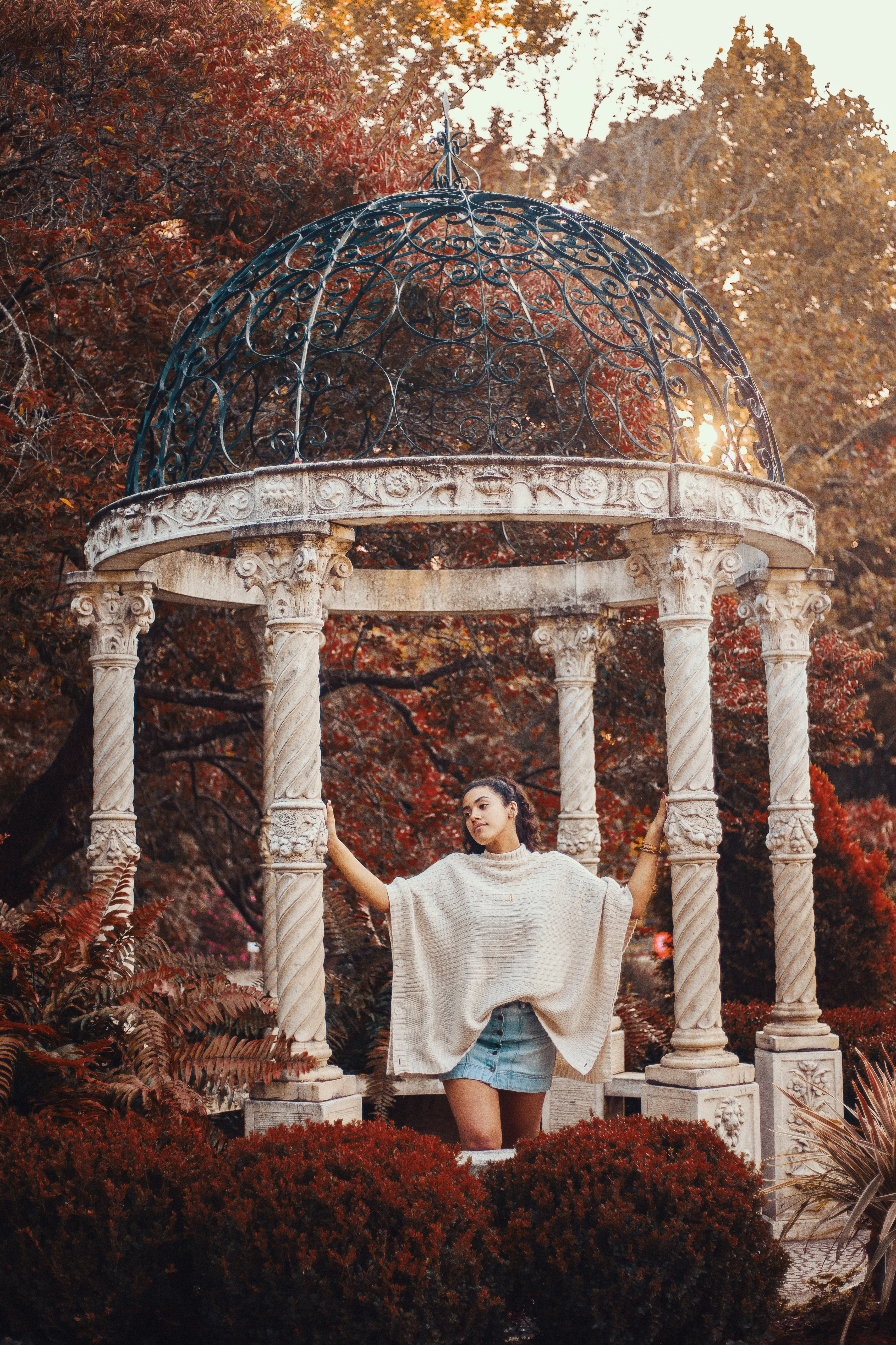 photography of woman holding gazebo post