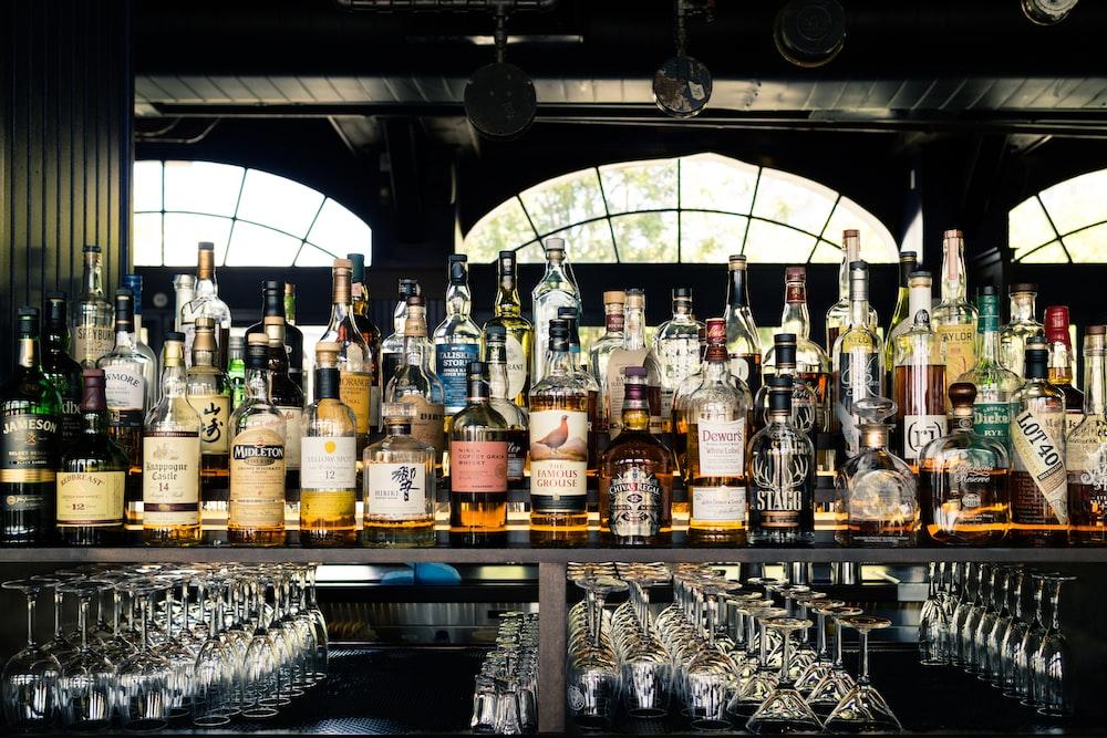 assorted liquor bottles on table