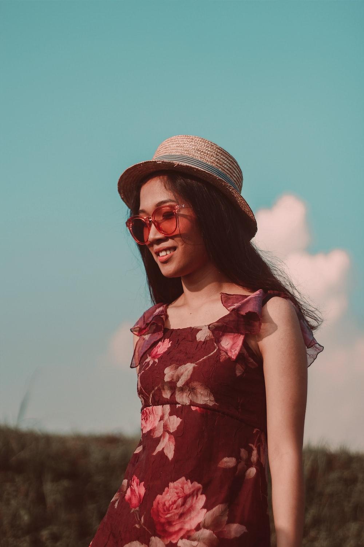woman happily walking along a grass field