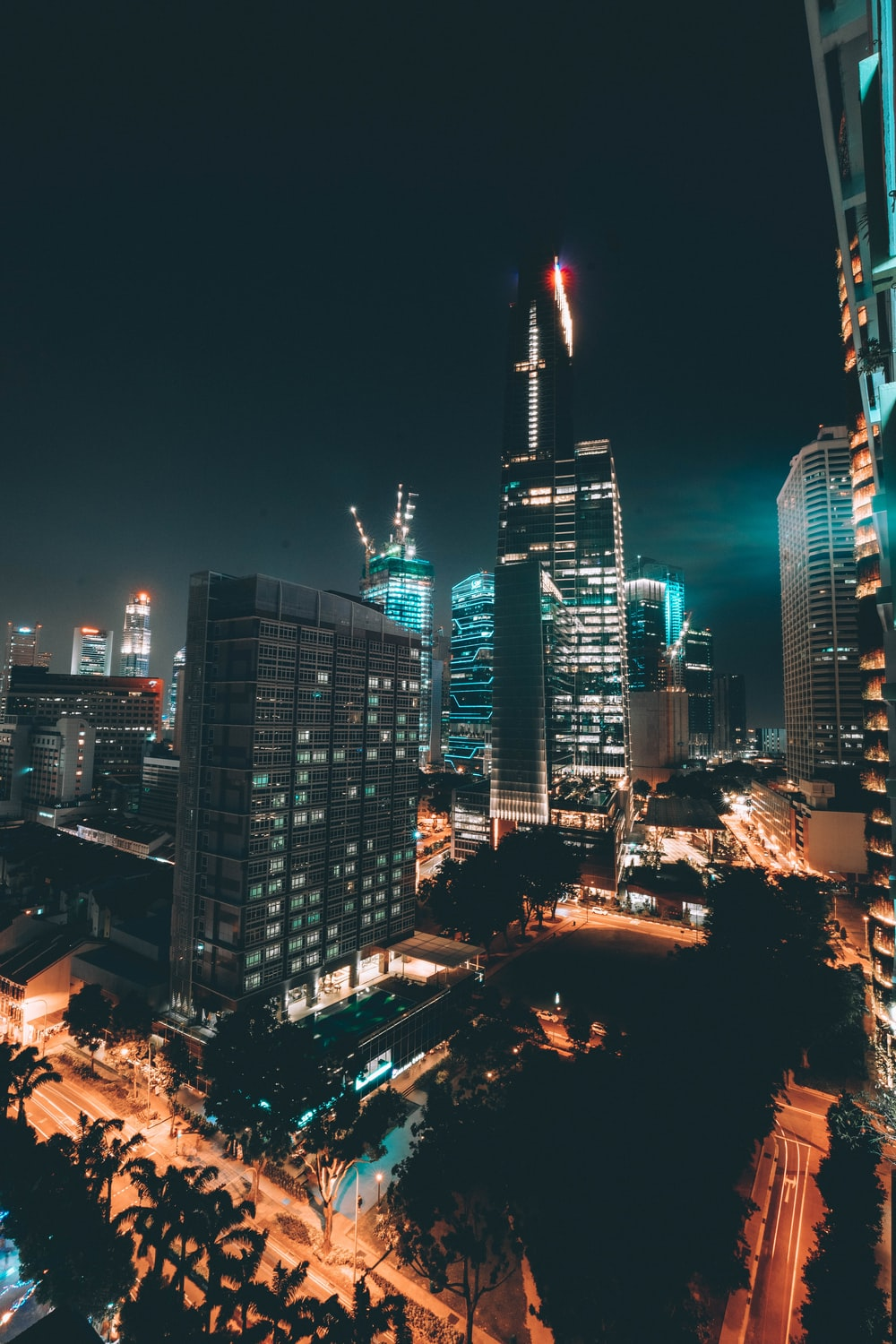 photo of lighted high-rise buildings in city during nighttime