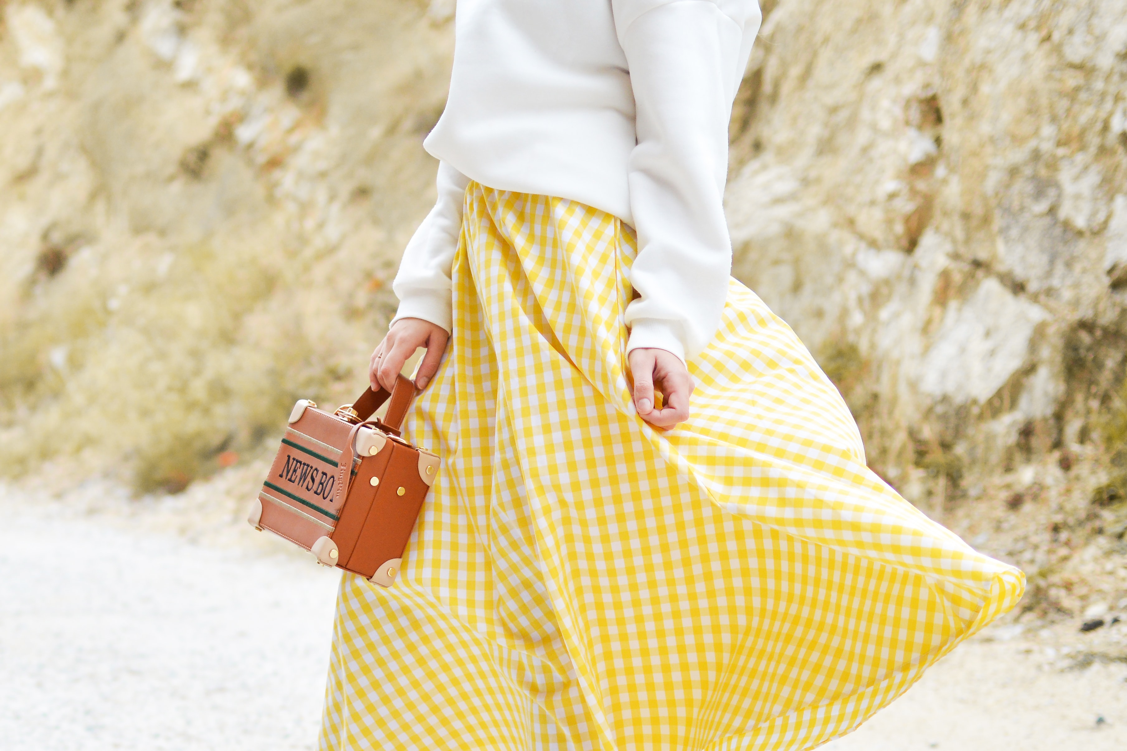 woman in yellow and white checked skirt