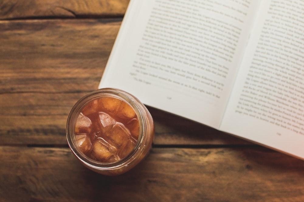 cup of juice near book