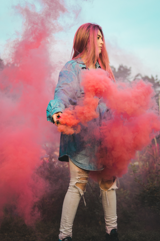 woman holding red smoke
