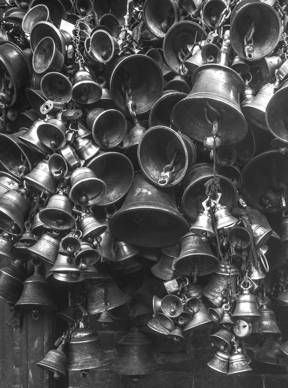 grayscale photo of bells