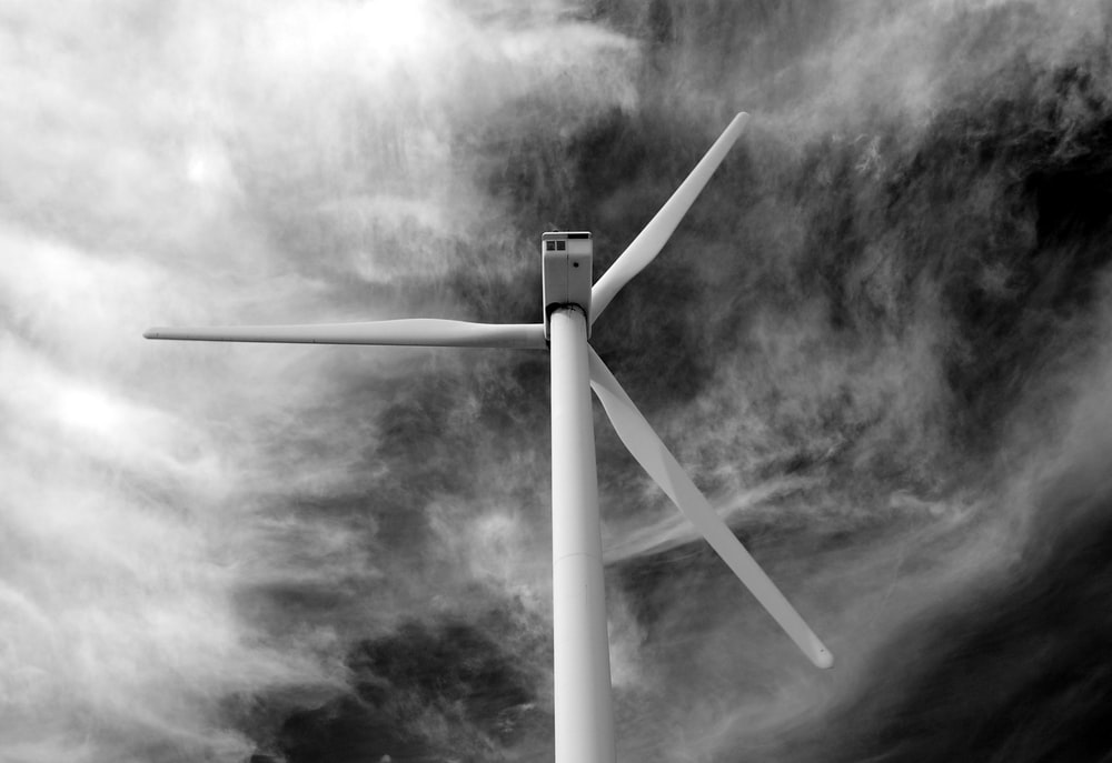 grayscale photo of wind turbine