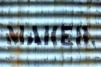 grey GI sheet with makeh text paint