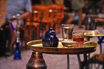 two glasses on tray egypt zoom background