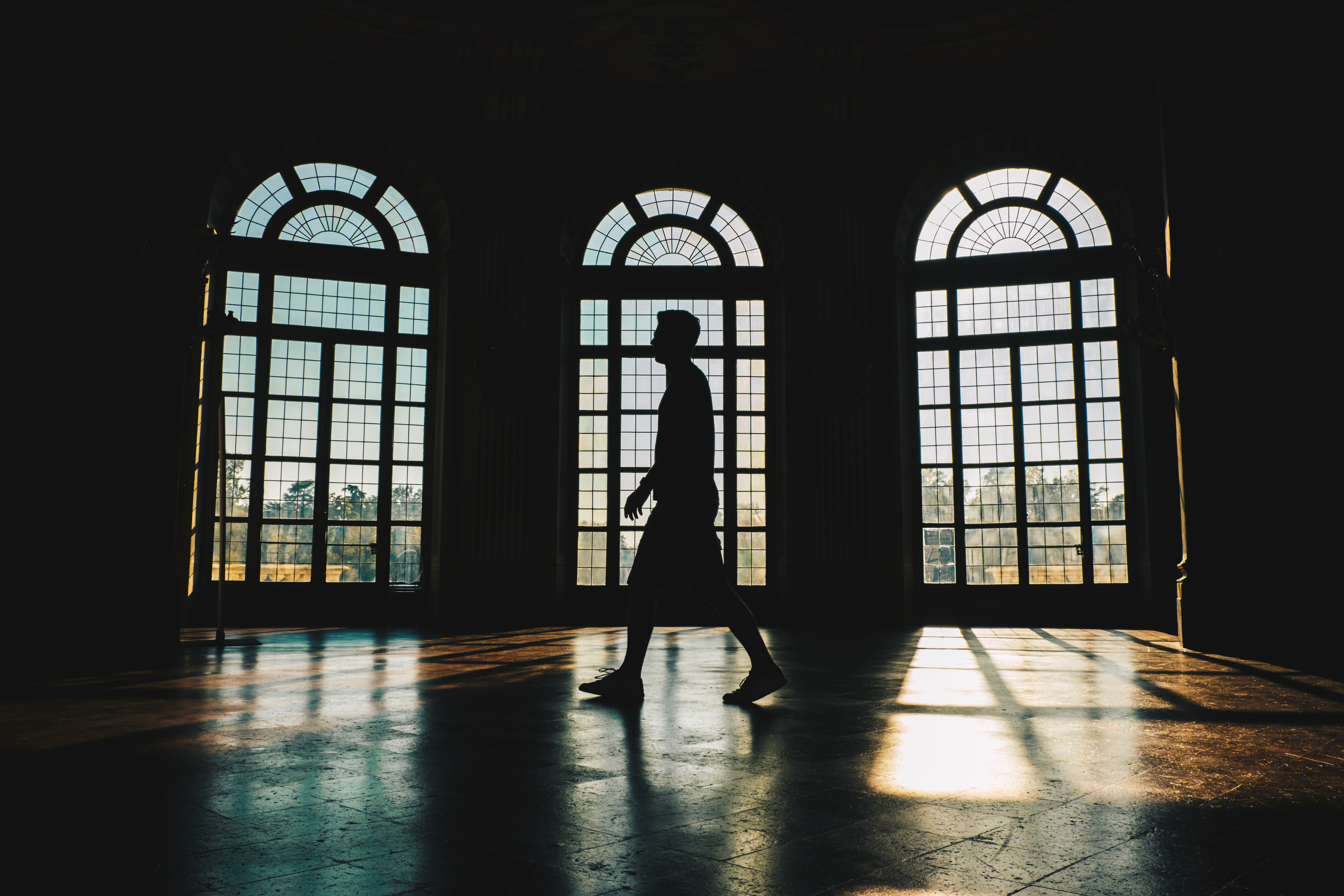 silhouette of person inside building