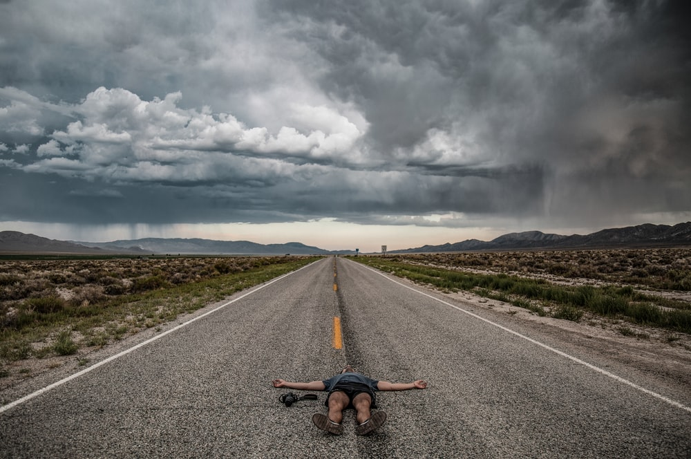 photography person lying on road