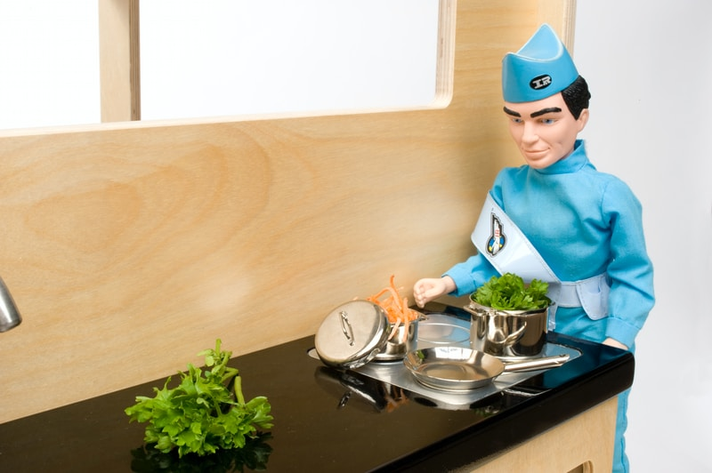 chef standing in front of table