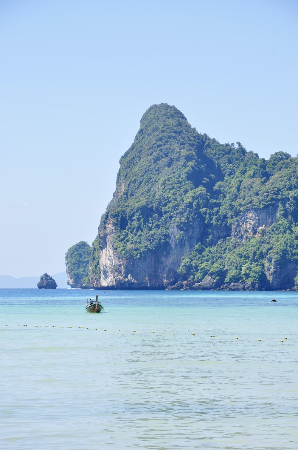 boat on sea far away from island
