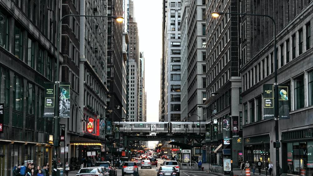 busy road in between buildings