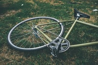 bicycle down on green grass field
