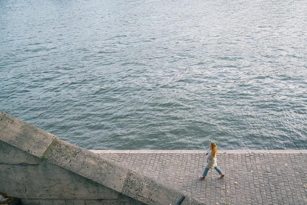 woman walking near ocean
