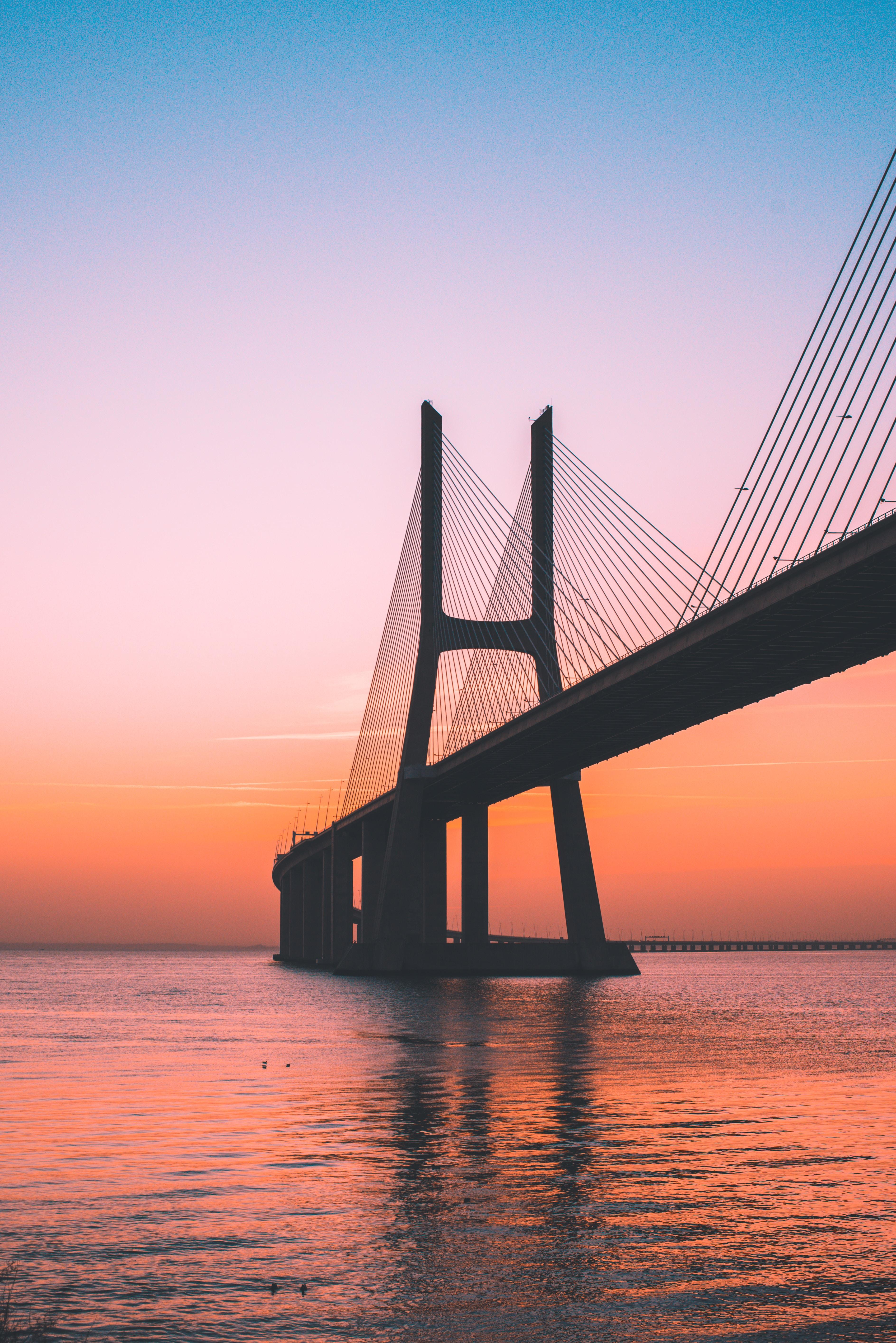 silhouette of bridge under clear sky