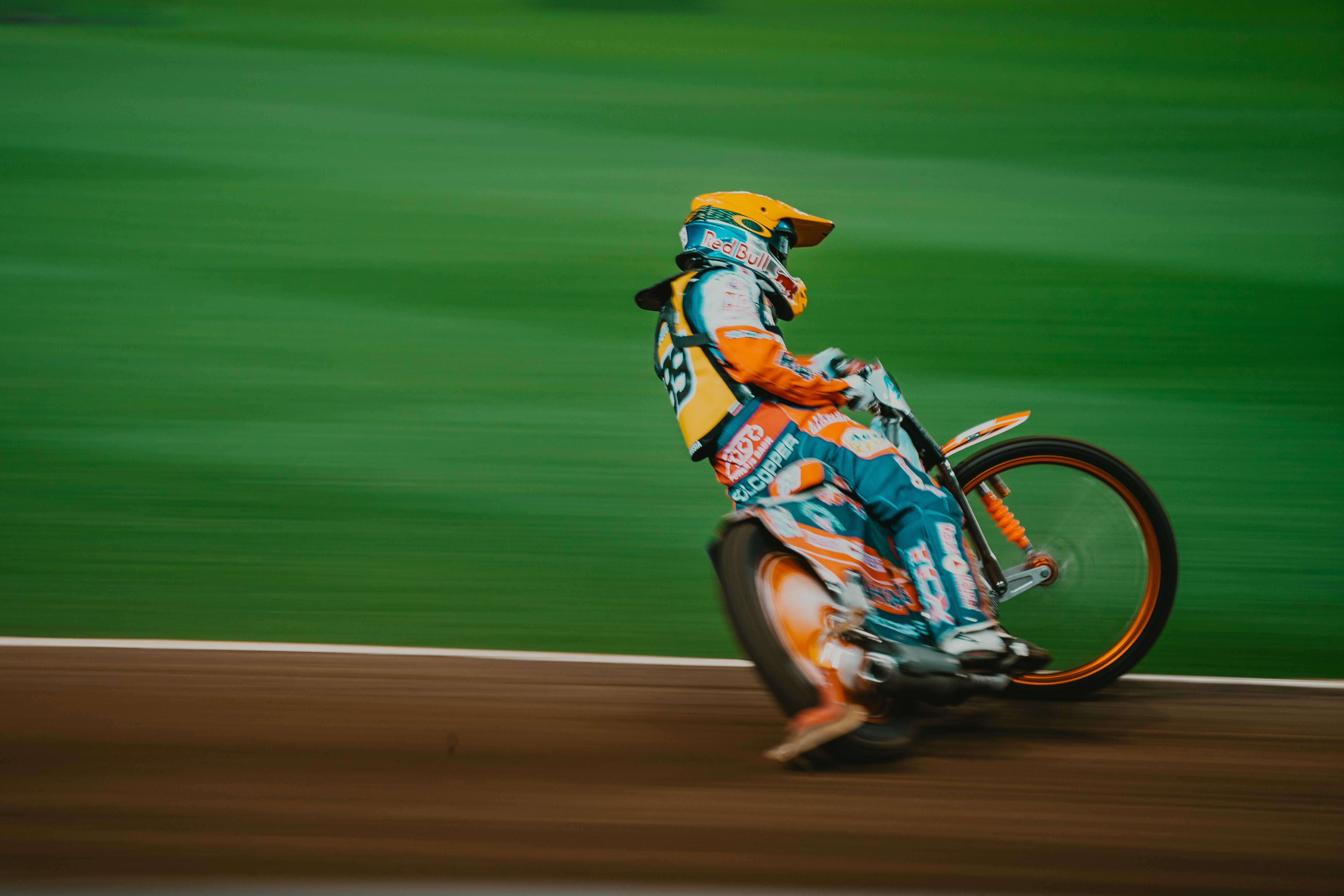 man riding motocross bike on panning photography