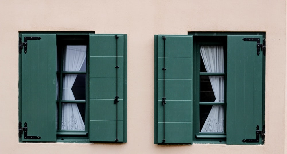 two green opened windows