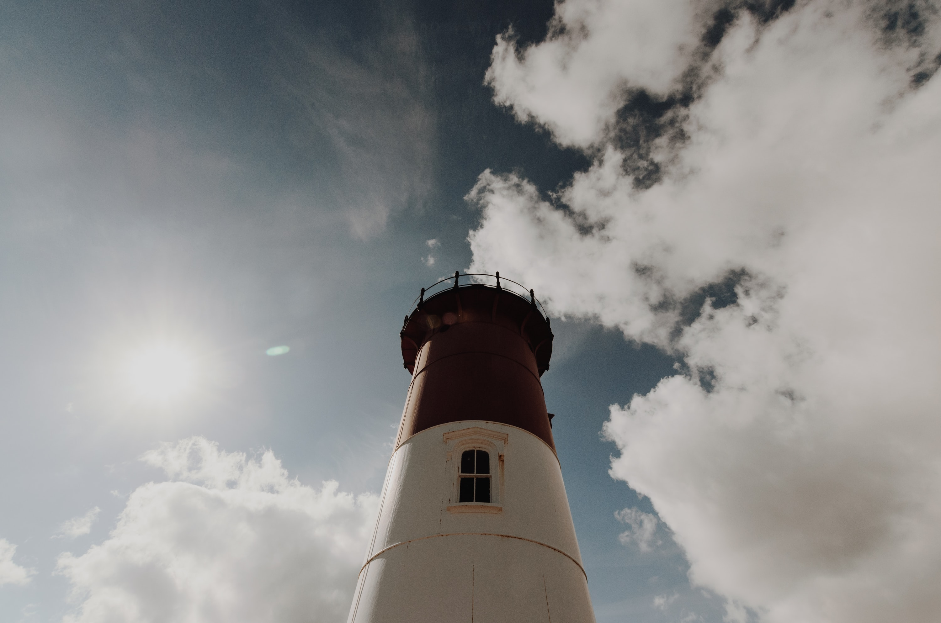 high-angle photography of white and black lighthouse tower during day time