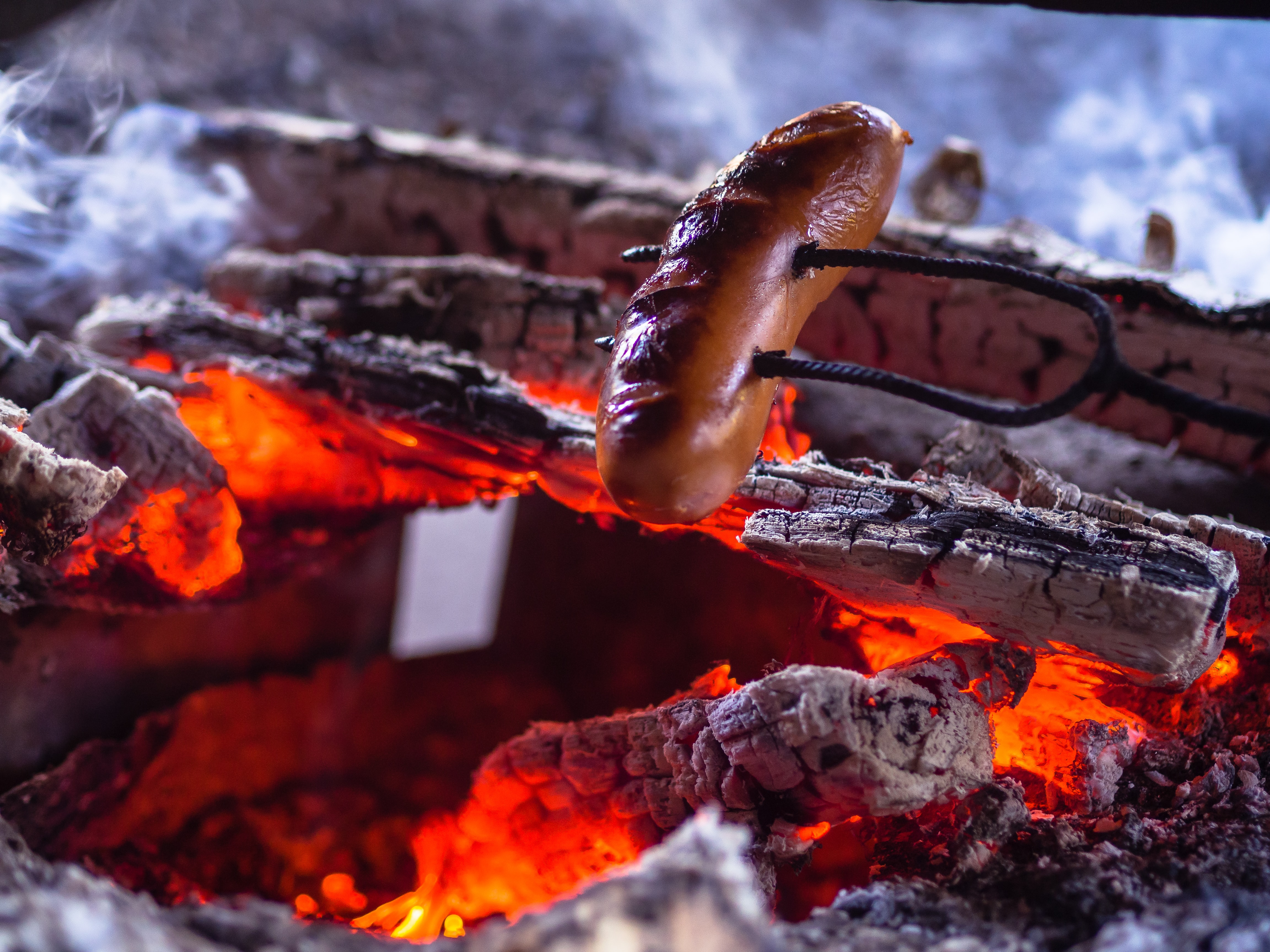 brown sausage on charcoal grill