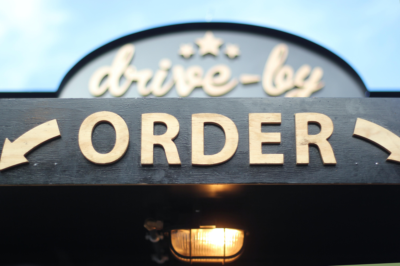 order signage on grey wooden plank
