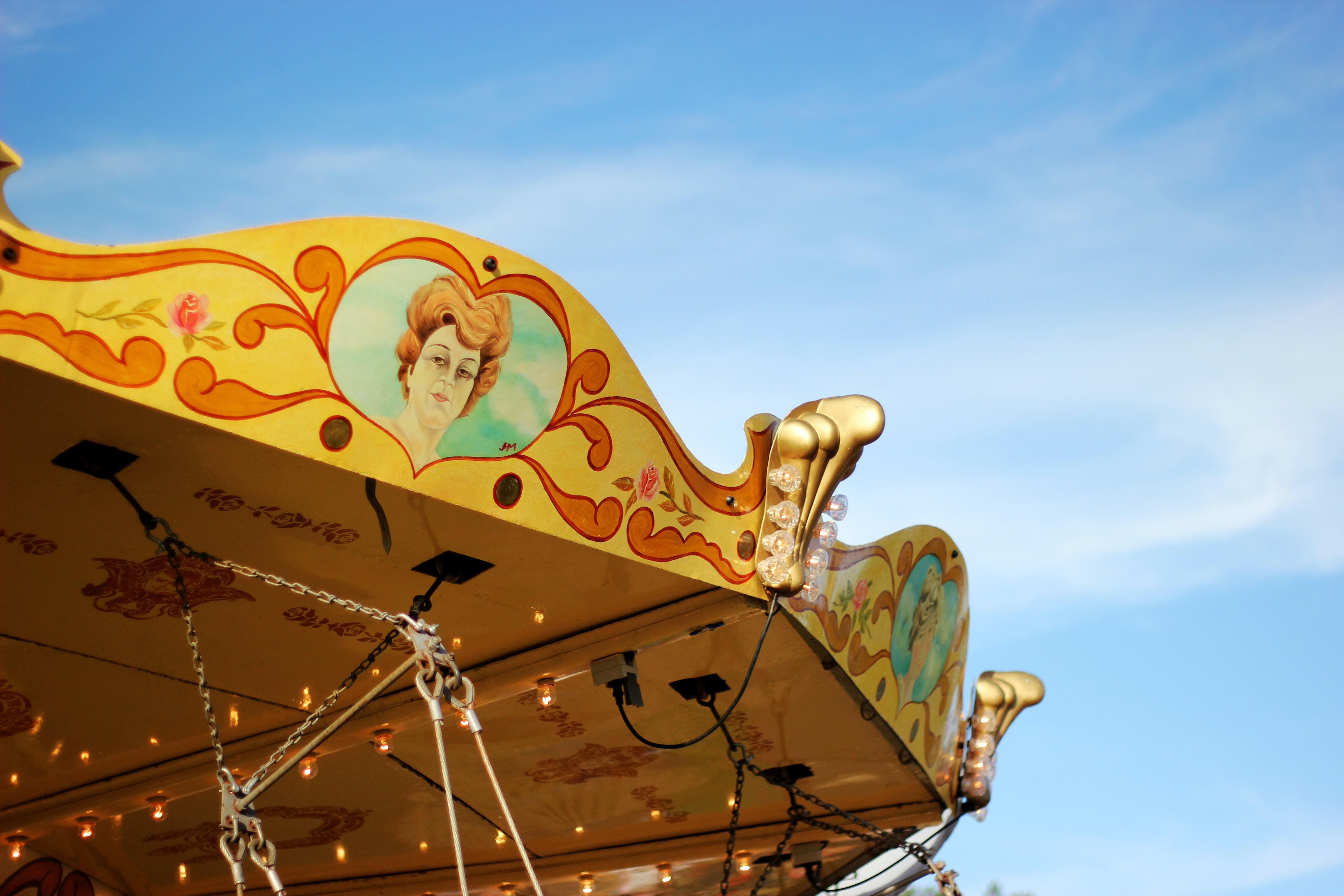 carousel under cloudy sky