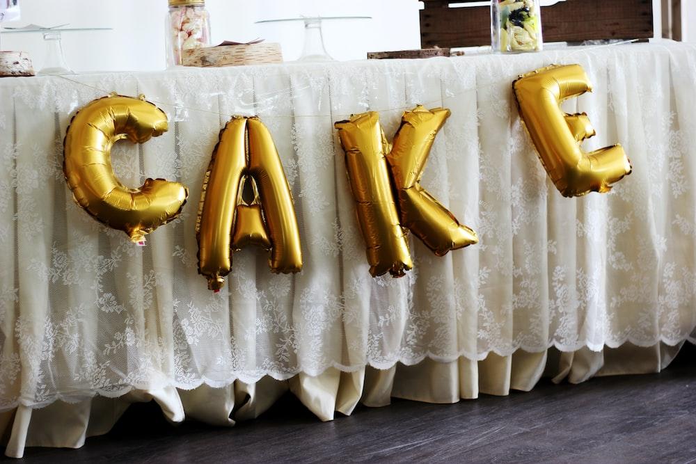 gold cake mylar balloons