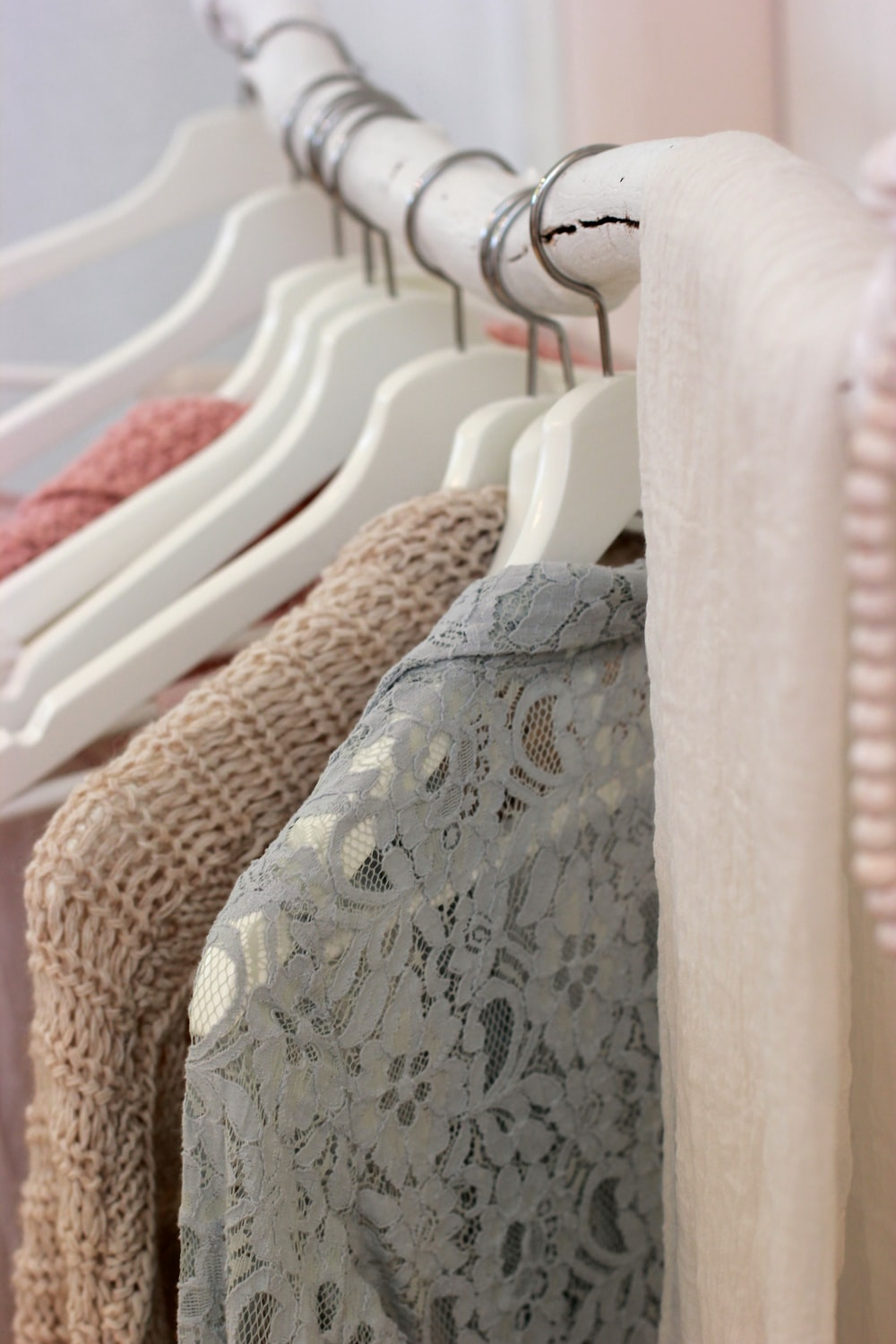 clothes hanging on white rack