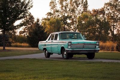 photo of green sedan on gray concrete floor michigan zoom background