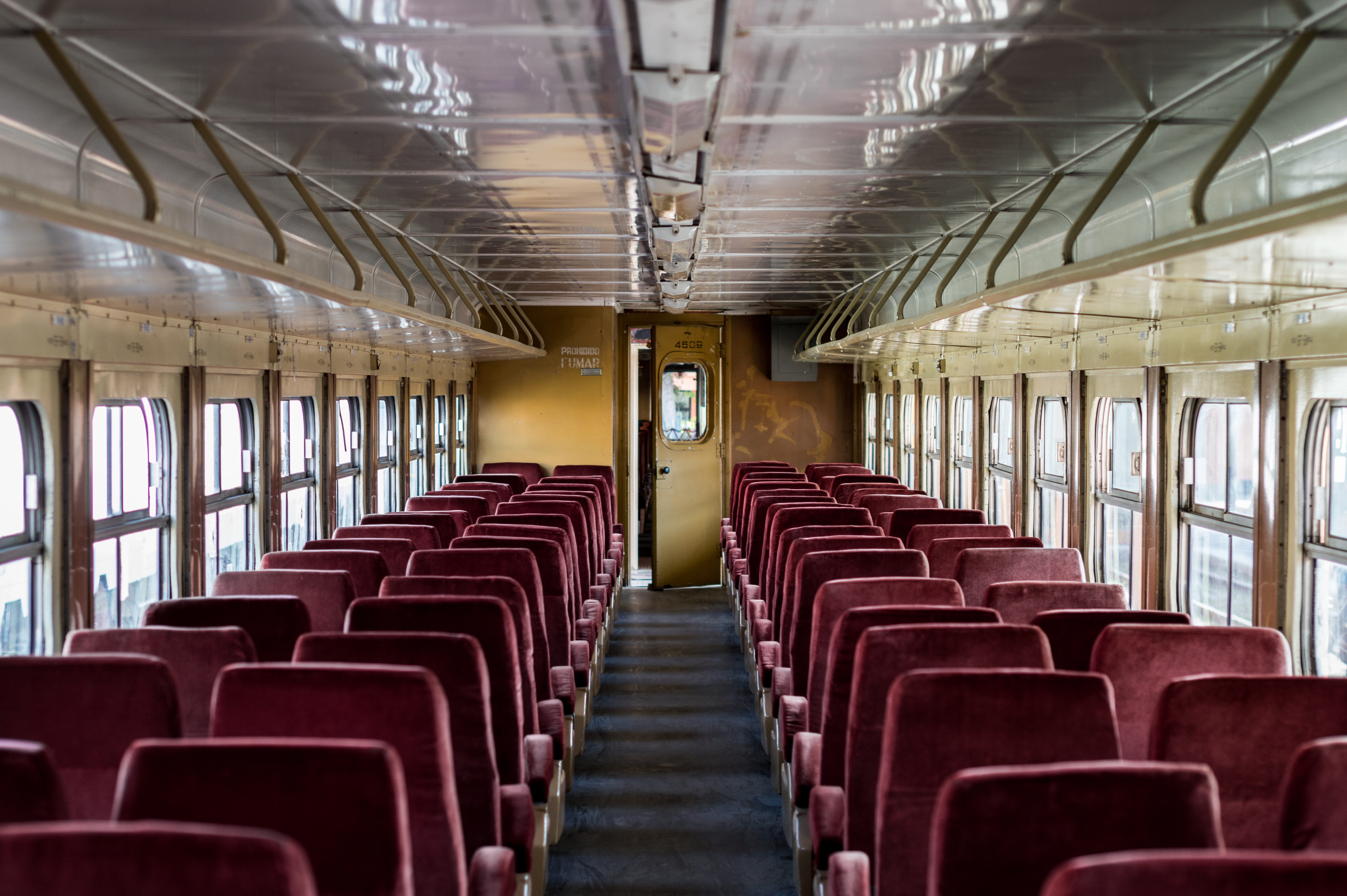interior of train with red chairs