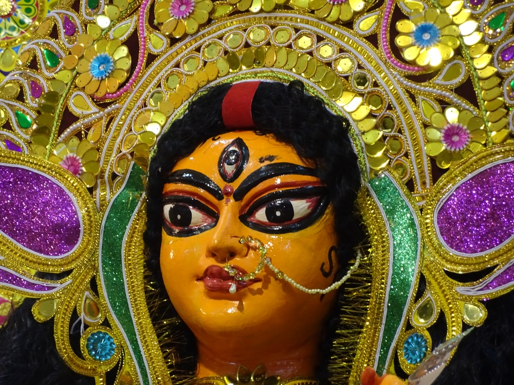 woman in black curl hair figurine